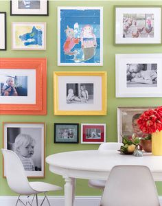 Creative ways to display kids art: Mix your kids artwork in with your family photos.