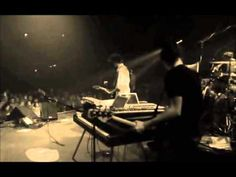 David Crowder Band-For the Glory of it All-live  Click on this and then on the YouTube link.
