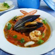 Bouillabaisse - This soup recipe is chock-full of seafood! A rich tomato broth pairs perfectly with succulent seafood.