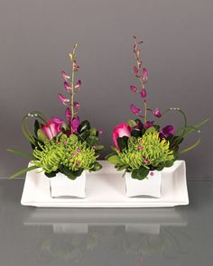 Green anastasia , hot pink roses, purple dendrobium orchids and lily grass, accented with pink beads and a few small gems to add a hint of sparkle