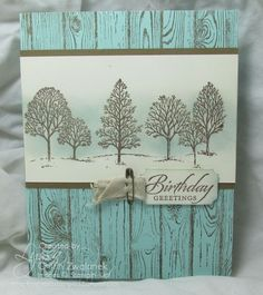 "By Lyssa Griffin Zwolanek. Stamp ""Hardwood"" (Stampin' Up) in Soft Suede ink on Pool Party card front. On white panel, stamp trees from ""Lovely as a Tree"" (Stampin' Up) in Soft Suede & sponge with Pool Party. Mount on Soft Suede mat. Add sentiment."