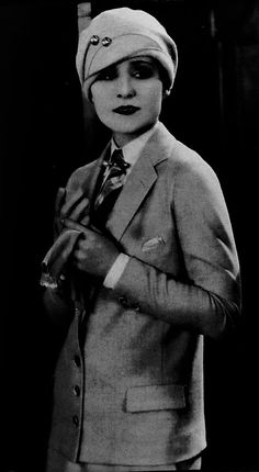 Early (1920's) photo of Marlene Dietrich in men's clothing, looking as sexy as ever in her androgeny.