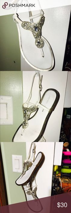 Antonio Melani sandals so bling bling sz6.5 pretty Antonio Melani sandals not sure spelled right lol very blingy lots of rhinestones in these very nice pair has two of the stones missing but I take very good care of my stuff so make a offer ANTONIO MELANI Shoes Sandals