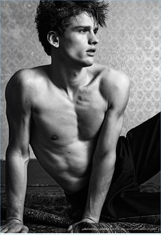 Sitting for a shirtless photo, Simon Nessman wears Givenchy trousers.