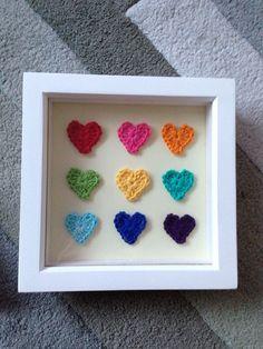 Rainbow crochet hearts in a box frame.