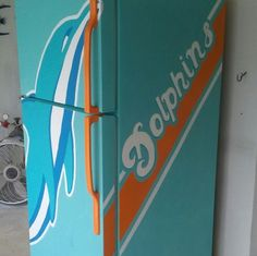 I painted my neighbors out door patio fridge for her. Miami dolphins painted frigerator man cave  Pamzylove.com