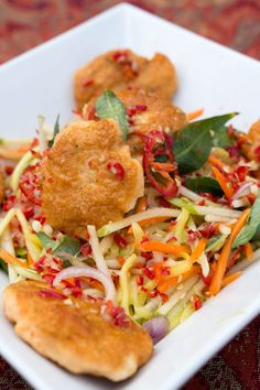 Smoked Fishcake Salad - green apple and mango topped with Thai-style fish cakes made with prawns and smoked trout.