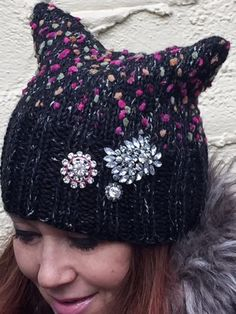 In tandem with The PussyHat Project, we are handlooming special statement headwear for the International Womans Day Marches, A Day Without A Woman and the PussyHat Global Virtual March on March 8, 2017. Our PussyHats have been worn by participants in the Womens March in Washington, DC, NYC and other US locations on January 21, 2017. Though the Pink PussyHat is iconic, this Black-Fuschia mix option ups the fashion ante. Make this a fashion DO and empower womens issues! Proceeds from the sale…