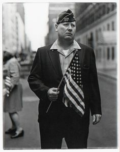 Diane Arbus: Veteran with a flag, N.Y.C.: 1971: Photography: She is famous for her controversial photos of people in their everyday lives.