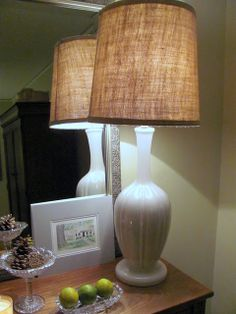 DIY burlap covered lampshade - I recently did this for the lamps in the living room. The burlap on mine is secured with jute so it has the flexibility to be more temporary, but I'll definitely use her idea of creating a burlap band to cover up the jute and add a more finished look. I really like the look, especially with the light on. It provides a rustic glow. *Hint: Buy burlap at a ranch store. It's way less expensive than anywhere else I've found ($8 for 8 yards).