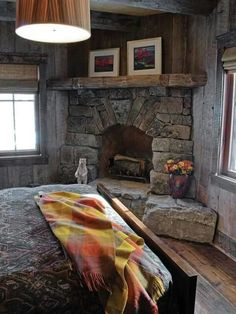 Dry Stacked Stone Corner Fireplace in Rustic Cabin Bedroom - on HGTV - TAGS: Cor. Cabin Fireplace, Small Fireplace, Bedroom Fireplace, Fireplace Design, Fireplace Ideas, Corner Stone Fireplace, Fireplace Makeovers, Fireplace Mantles, Fireplace Furniture