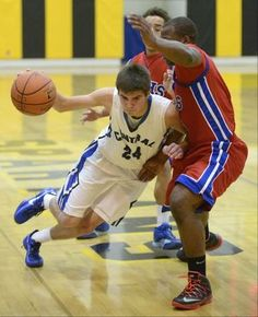 Burlington Central's Brett Rau forces his way to the hoop around Dundee-Crown's Cordero Parson in the first quarter on Tuesday, November 26....