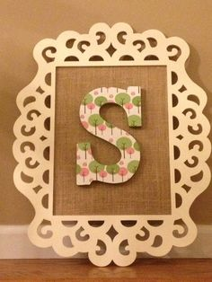 Painted Cheap laser cut wood frame from Michaels with Burlap inside. Can use anything in the middle.