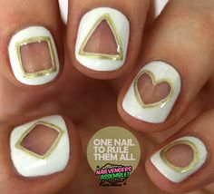 The base for these nails was OPI - My Boyfriend Scales Walls, then I used Barry M - Gold Foil to draw the shapes using a brush, and acetone and a wide brush to clean up the space. Then I used Seche Vite to top it off