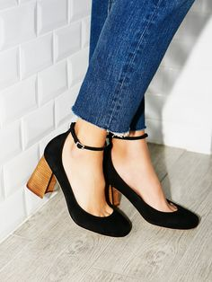 Delta Heel   Super cute modern Mary Jane style heels featuring a rounded toe and adjustable ankle strap. Easily dressed up or down with a stacked block heel.