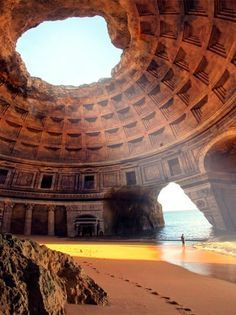 "This is captioned as ""The Forgotten Temple of Lysistrata, Portugal"" NOT TRUE! This is the Benagil cave in Algarve,Portugal. NO RUINS of a temple, those are photoshopped in from the Pantheon. Places Around The World, Oh The Places You'll Go, Places To Travel, Places To Visit, Around The Worlds, Travel Destinations, Greece Destinations, Places Worth Visiting, Holiday Destinations"