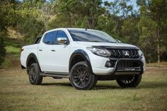 Special edition Mitsubishi Triton GLS Double Cab lands… The popular Mitsubishi Triton is now being offered in a special edition model known as the GLS Sports Edition. Available in Mitsubishi dealers now, the special [. Mitsubishi Pickup, Mitsubishi L200, Mitsubishi Colt, Triton 4x4, Triton L200, Gmc Denali, Car Interior Accessories, Vans, Bmw