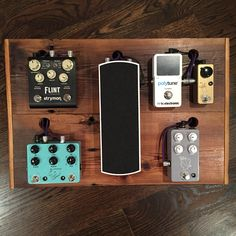 Custom reclaimed barn door turned pedalboard. JHS pedals, Strymon Engineering, TC Electronics, Voodoo Labs Pedal Power, Lava Cable tightrope patch cables.