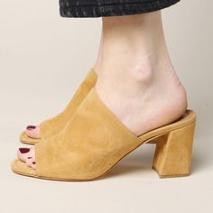 The Maryam Nassir Zadeh Penelope Mule is light brown women's mule. Made of suede, it features a block heel. - Materials: 100% goat suede - Made in Turkey - Size: Euro shoe sizing, size 37 is women's U