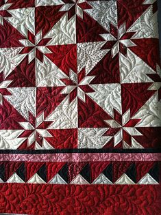 Hunters star - I have made one of these in white and blue, but haven't finished it because I I haven't known how to quilt it. I like the quilting on this quite a bit.