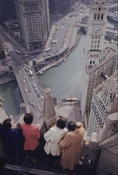 Tourists atop the Chicago Tribune building look down on the Chicago River, the site of Old Fort Dearborn. Photo by Anthony Stewart, National Geographic, undated. Oh The Places You'll Go, Places To Travel, Places To Visit, Chicago Tribune, Chicago Illinois, Chicago Trip, Visit Chicago, Chicago Chicago, Chicago Photos