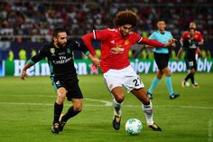 Marouane Fellaini and Dani Carvajal during the Super Cup match, Skopje, Macedonia Uefa Super Cup, Official Manchester United Website, Live Matches, Match Highlights, Man United, Sports News, Real Madrid, The Unit, Change