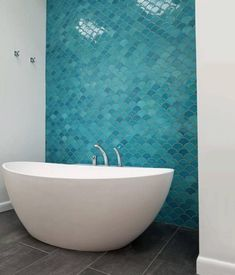 Perfect for bathrooms, our aquamarine scallop tiles are inspired by the ocean. Install these tiles to create a bright, refreshing atmosphere in any room. Moroccan Bathroom, Tropical Bathroom, Modern Bathroom, Master Bathroom, Caribbean Decor, Caribbean Homes, Bathroom Renos, Bathroom Renovations, Fish Scale Tile