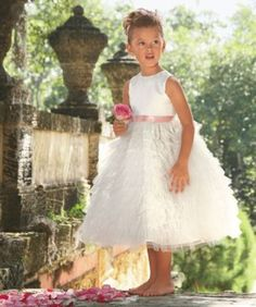 Here comes the charm. Tiers of soft tulle are light and ethereal, creating a lush, romantic skirt.