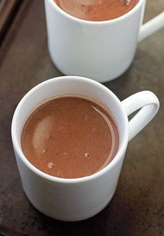 Mexican Hot Chocolate {Slow Cooker} A twist on the traditional Hot Chocolate. Easy to make and it's perfect to serve guests! #hotchocolate #slowcooker #crockpot  Littlespicejar.com