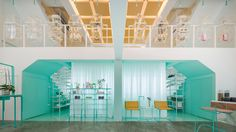 Sections of bright turquoise paintwork and matching furniture offset the otherwise white-washed treatment rooms of this Bangkok spa.
