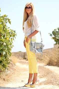 I love these yellow pants...and the heels....and the shirt....basically everything about this look is adorable :)