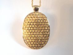 """Fitbit One pendant / necklace - Oval """"Honeycomb"""" Gold tone with gold leather"""