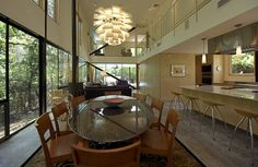 Single level kitchen serving double level dinning space.