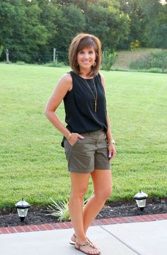 Summer Fashion For Women Over 40. black shirt, grey Bermuda, animal print sandals.