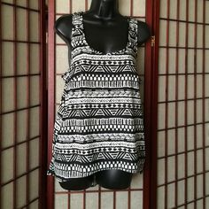Top Black and white tribal top with razor back. Back is longer then front. Very light material. Tops Tank Tops