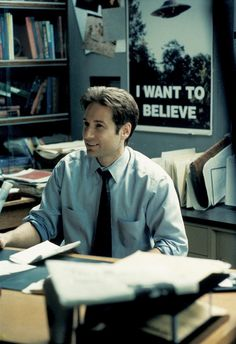 Agent Fox Mulder, from the X-Files. I love this picture, so happy to see this on the geek board without having to look for it :)