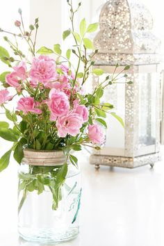 Soft flowers, twine, and mason jars - makes for the perfect spring time decor!