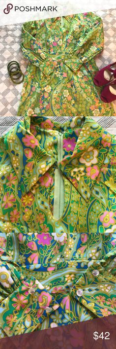 """Darling vintage dress In excellent vintage condition. Wild '60's floral print with dominant green and blue background. Long sleeves with pearly buttons at the cuffs. Keyhole opening at the collar. Banded waist. Zips up the back. Measurements lying flat: bust 18"""", waist 17"""", hips 23"""". Length from shoulder to hem: 39&1/2"""". Vintage Dresses"""