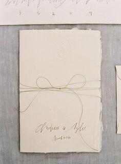 handmade-paper-deckled-edge-rough-ivory-pencil-hand-lettering-wedding-invitation-bow-twine.jpg