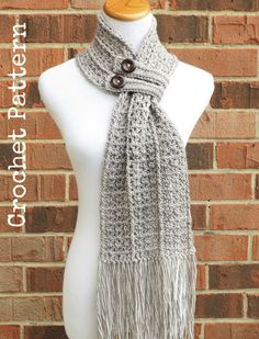 THIS LISTING IS FOR A DIGITAL DOWNLOAD PDF PATTERN (INSTRUCTIONS TO MAKE THE SCARF YOURSELF), NOT A FINISHED CROCHETED SCARF. THE PATTERN INSTRUCTIONS ARE IN ENGLISH ONLY. The Hartford Buttoned Scarf is a beautiful, lacy scarf featuring a unique construction, extra-long fringe and two