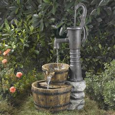 Old Fashion Water Pump Fountain. this would be perfect in a garden!