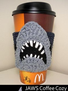 JAWS Coffee Cozy Crochet Pattern - maybe funny coffee cozies should be this year's holiday gifts Crochet Coffee Cozy, Crochet Cozy, Crochet Gifts, Cute Crochet, Crochet Yarn, Cozy Coffee, Coffee Cup, Coffee Plant, Coffee Creamer