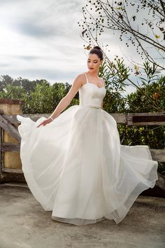 The breath taking 'Maggie' gown created in an Italian rose silk Jacquard with detachable full circle silk organza over skirt. So simple yet soooo stylish. From Bertossi Brides at Paddington Weddings