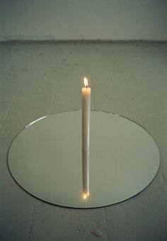 "by #OlafurEliasson (b. 1967) ""I grew up in solitude and silence"", 1991 Mirror and candle Ø 50 cm"