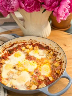 Baked Eggs with Green Chiles and Capers recipe from Geoffrey Zakarian via Food Network