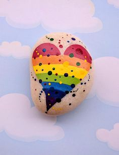 The heart is painted in acrylic paint and ink on a New England beach pebble and coated with clear satin finish polyurethane so it can be displayed inside or out. #paintedrock #heart #ad #paintedstone