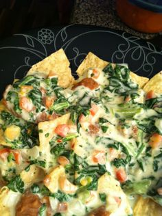 Gringo Dip  1 lb Velveeta Queso Blanco, cubed  1 cup pepper jack cheese, shredded  ½ cup shredded parmesan  16 oz container pico de gallo  1 cup milk  1 tsp cayenne  10 oz frozen chopped spinach, thawed and drained In a saucepan, warm the cheeses, pico, milk and cayenne. Stir until completely melted. Add the spinach, taking care to separate the leaves. Serve with chips, on nachos, or with waffle fries.