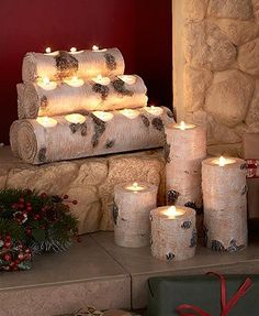 """Use the Woodland Tea Light Candleholders to create a relaxing atmosphere. Set of 4 Tea Light Holders (3"""" dia. x 3""""H, 4""""H, 6""""H and 8""""H) are designed to look like tree stumps. Each has a spot for your own 1-3/8"""" dia. candle."""