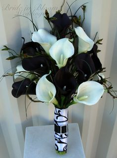 Black and white calla lily wedding bouquet...would like black, orange, purple with feathers and rhinestones!