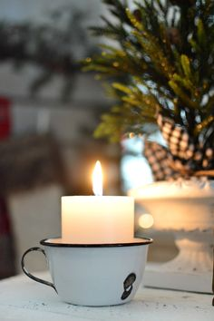What a sweet idea to put a candle in a cup in your Christmas vingette!!! Holiday Housewalk Christmas at the cottage - Fox Hollow Cottage Home Tour